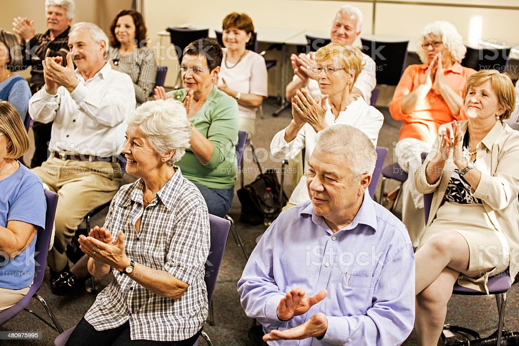 Seniors Give Applause After Great Show stock photo