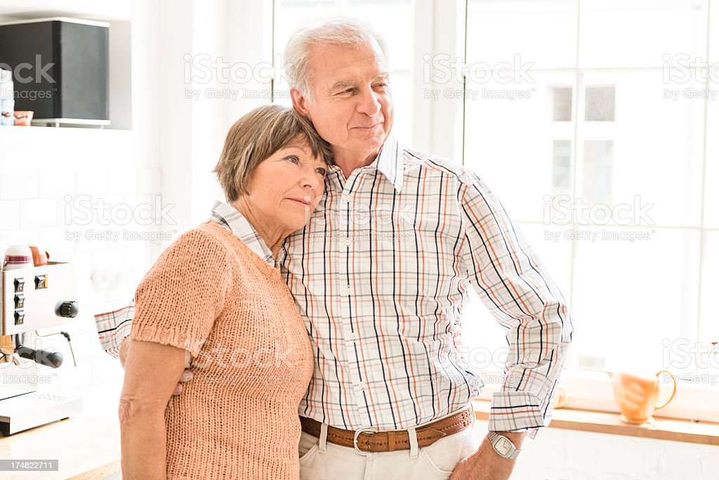 Seniors grandparents standing embraced on a Kitchen royalty-free stock photo