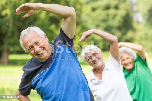 istock Seniors - gymnastics in the park 504037065