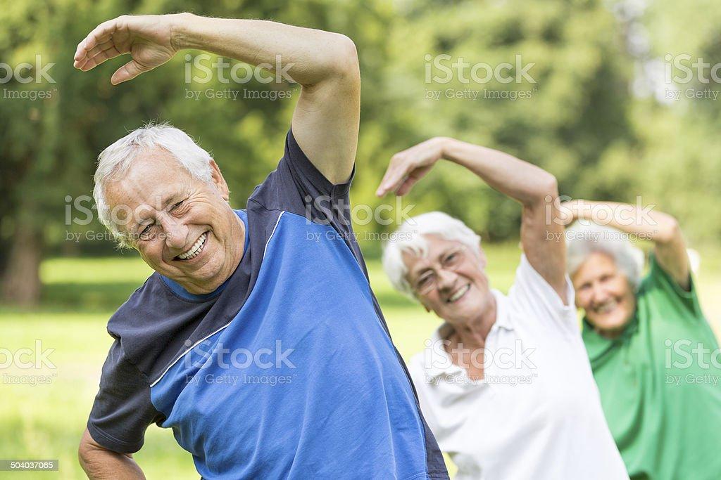 Seniors - gymnastics in the park stock photo