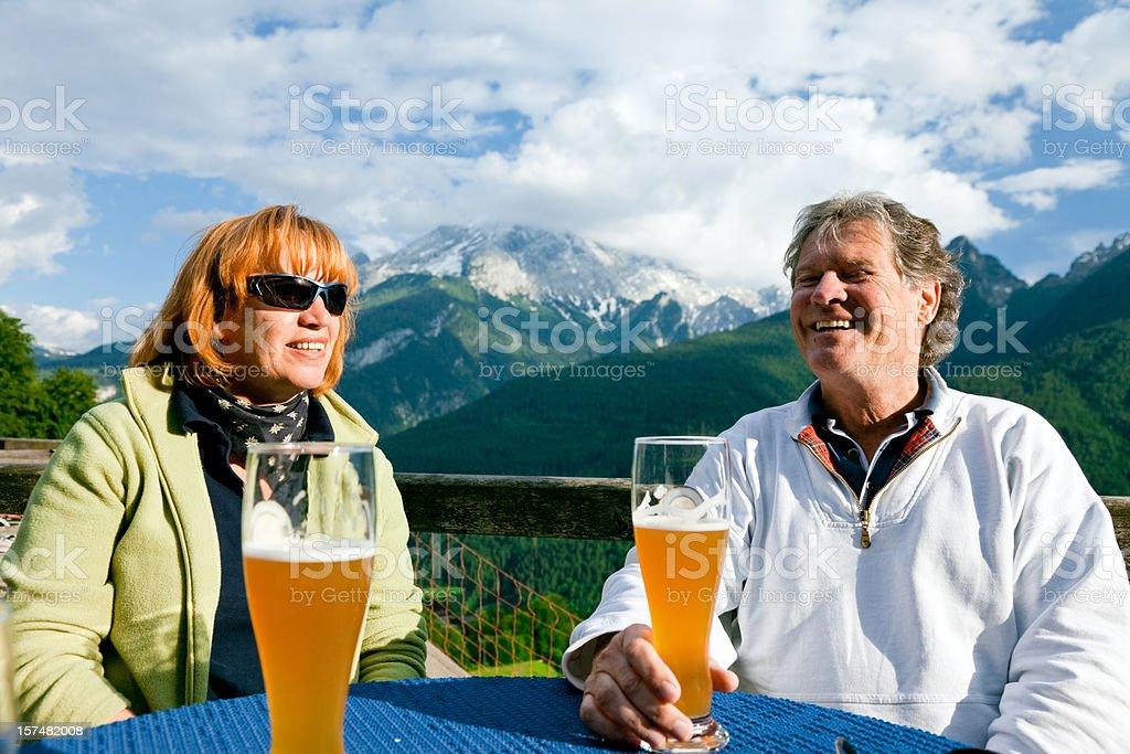 seniors having a drink in an alpine restaurant royalty-free stock photo