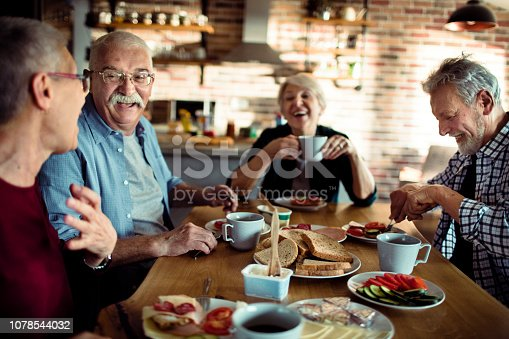 Close up of a group of senior people having breakfast