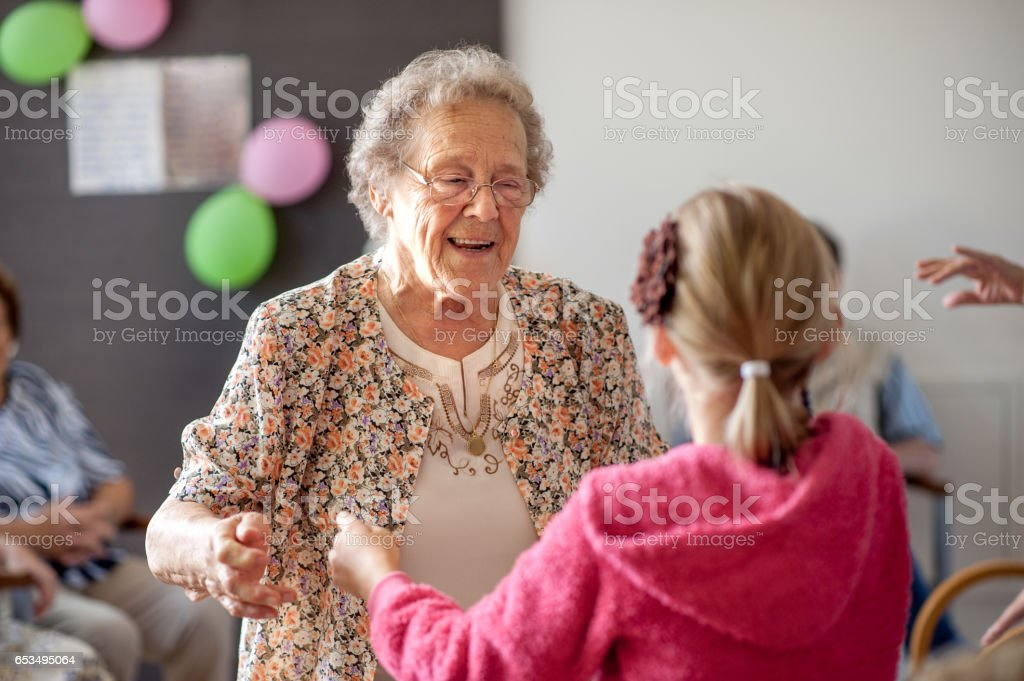 Seniors Having Fun In The Community Center stock photo