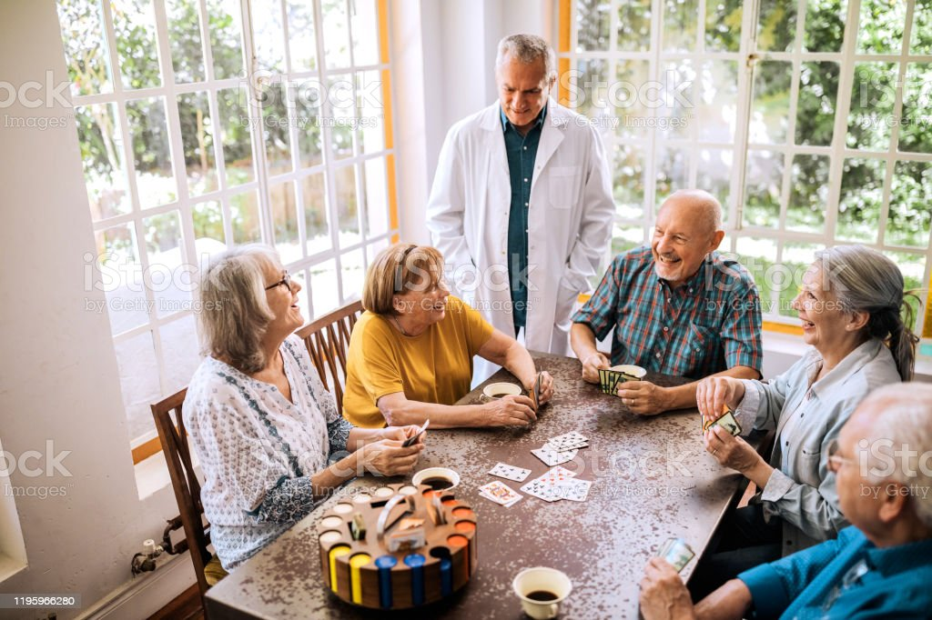 Seniors Having Fun Playing Cards In Nursing Home Stock Photo Download Image Now Istock