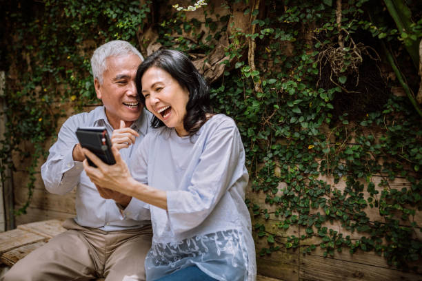 Seniors Having Video Call On Phone With Their Family stock photo