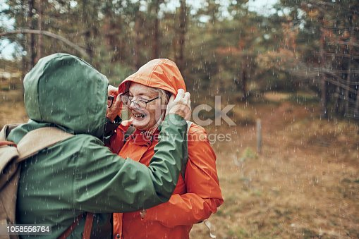 Close up of two female seniors hiking through the forest