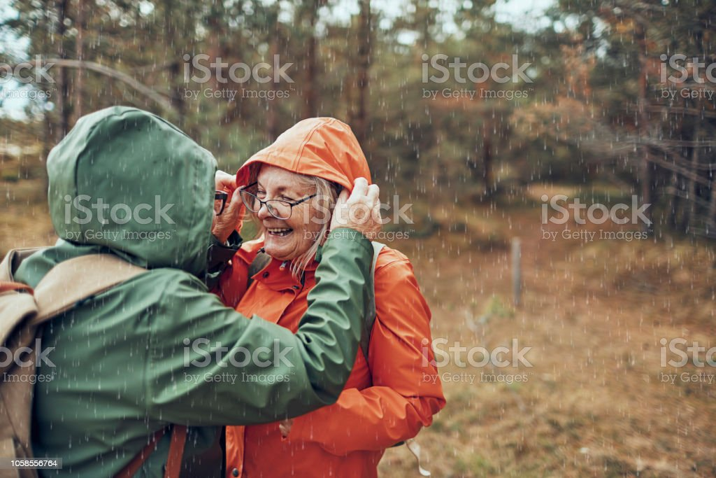 Seniors Hiking in the Rain stock photo