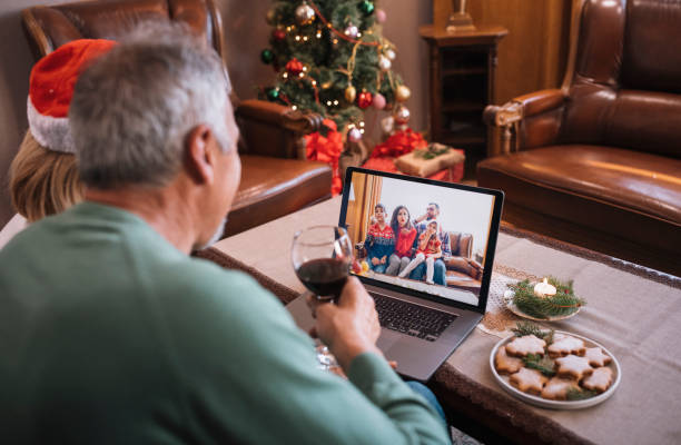 Seniors in Christmas video call, Online talking with family.