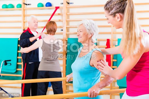 istock Seniors in physical rehabilitation therapy 625239304