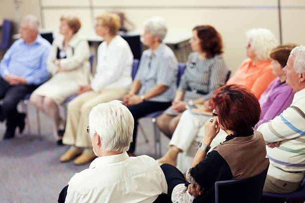Seniors in the community center Seniors on the seminar. group therapy stock pictures, royalty-free photos & images