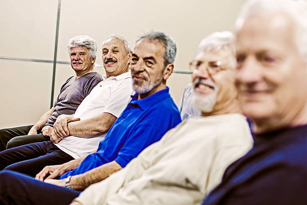 Seniors in the community center Group of senior men on the seminar, looking at camera. only senior men stock pictures, royalty-free photos & images