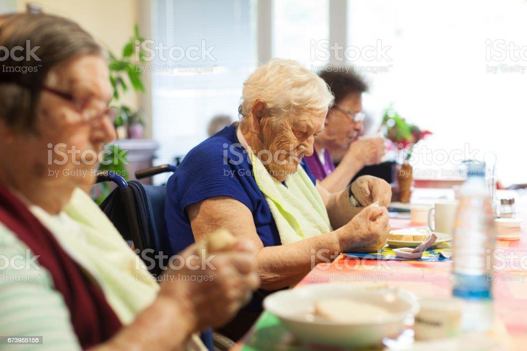 Seniors In The Nursing Home Having Breakfast In The Dining Room stock photo