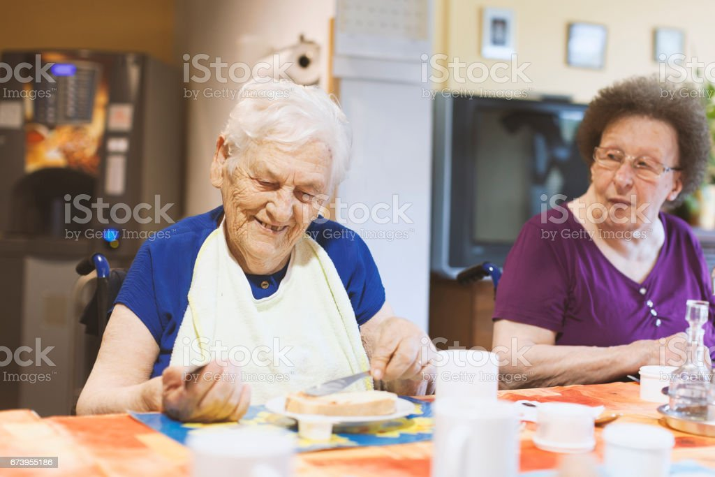 Seniors In The Nursing Home Having Breakfast In The Dining Room royalty-free stock photo