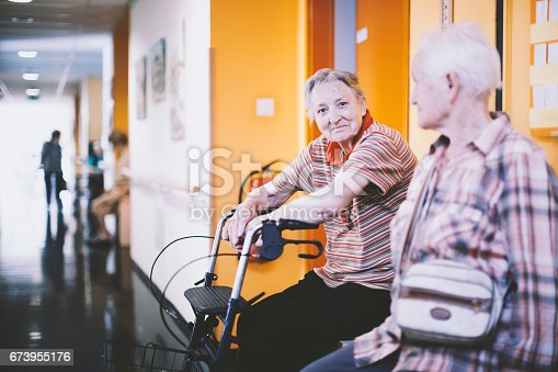 Seniors In The Nursing Home Resting In The Corridor