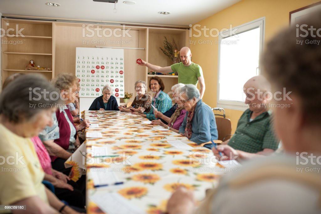 Seniors In The Retirement Community Spending Playing Bingo stock photo