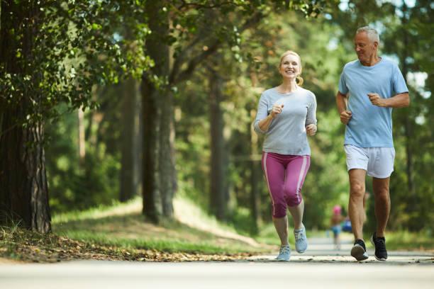 seniors jogging - shironosov stock pictures, royalty-free photos & images