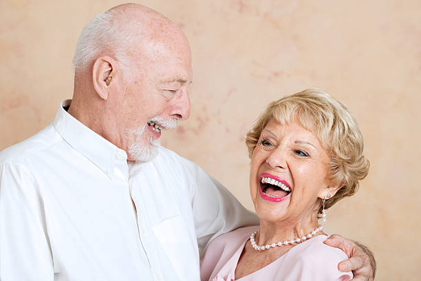 seniors laughing together - hearing loss stock pictures, royalty-free photos & images