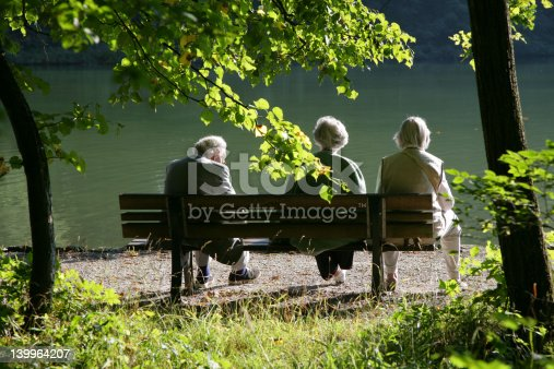 istock Seniors on a park bench 139964207
