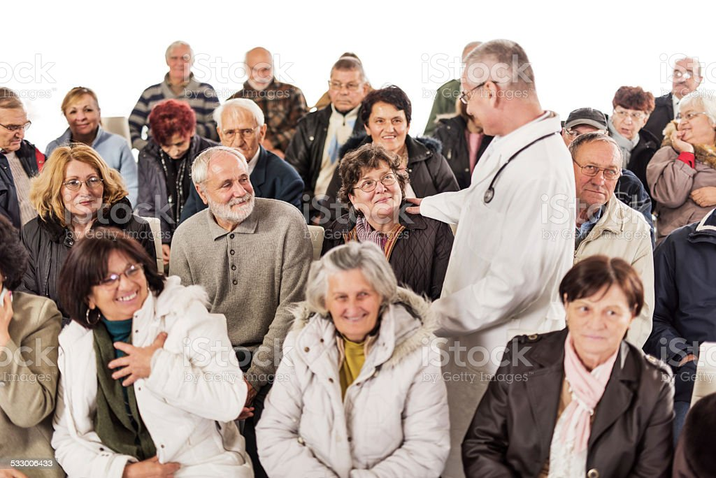 Seniors on a seminar about medicine. stock photo