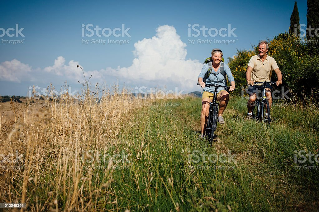 Seniors on Mountain Bikes in the Countryside stock photo