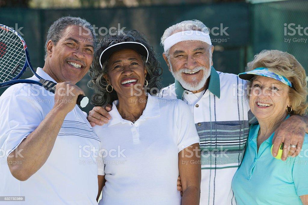 Seniors on the Tennis Court stock photo