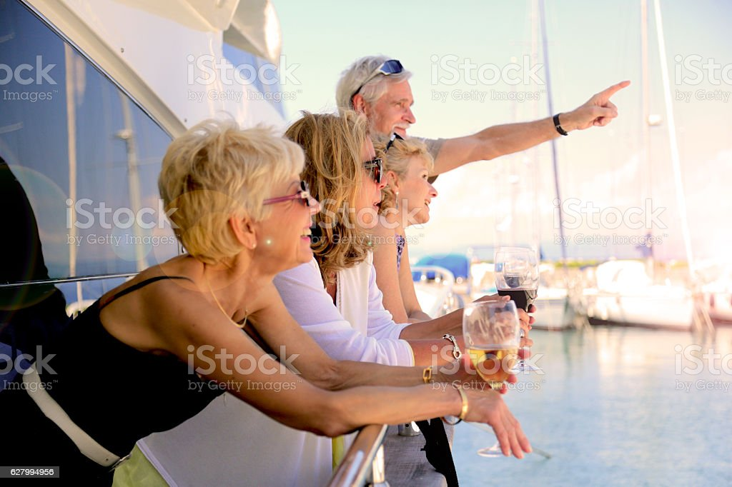 Seniors on yacht observing the beauty of the summer sky stock photo
