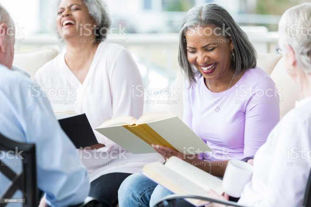 Seniors participate in Bible study stock photo