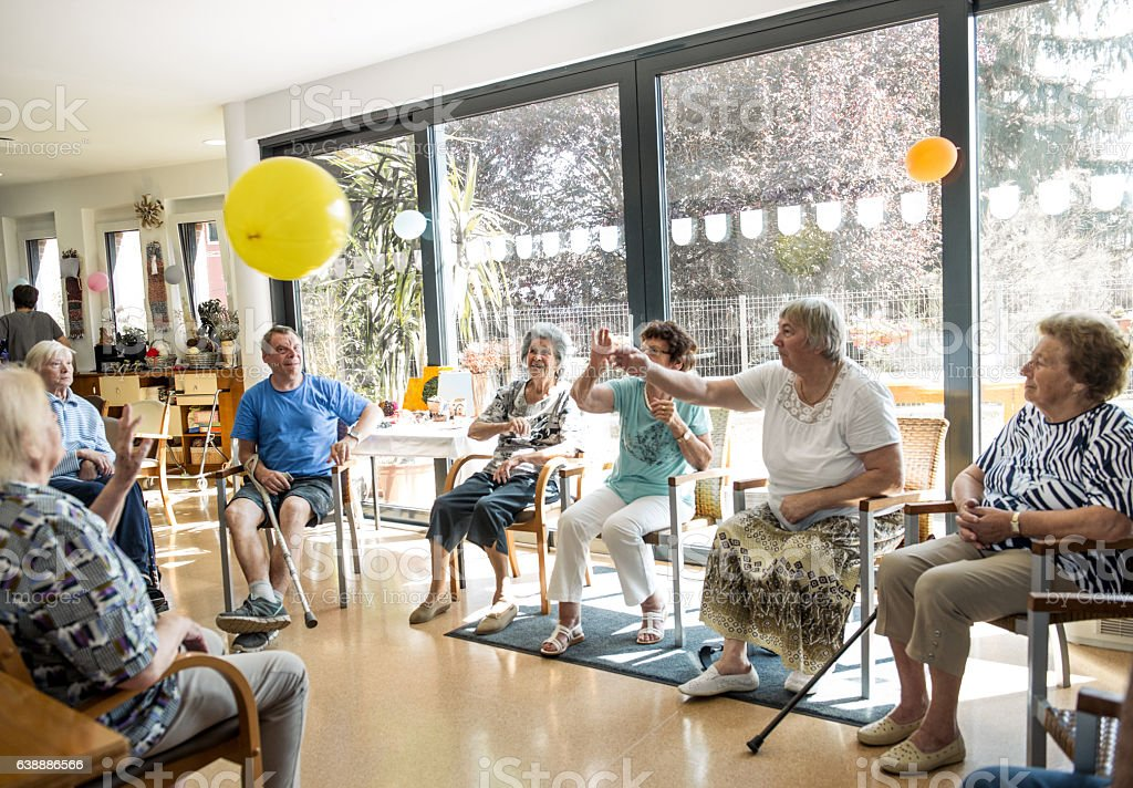 Seniors participating in Group Activities in Adult Daycare Center stock photo