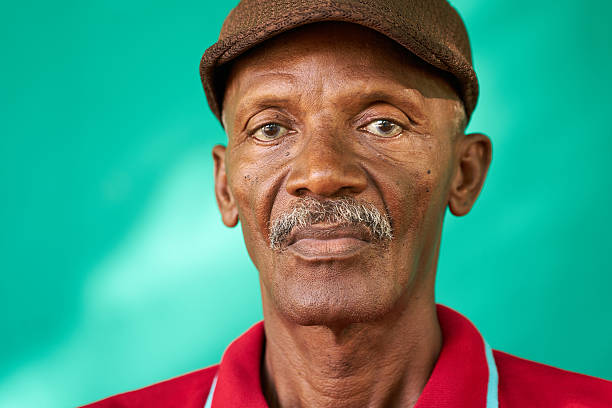 Seniors People Portrait Sad Old Black Man With Hat stock photo