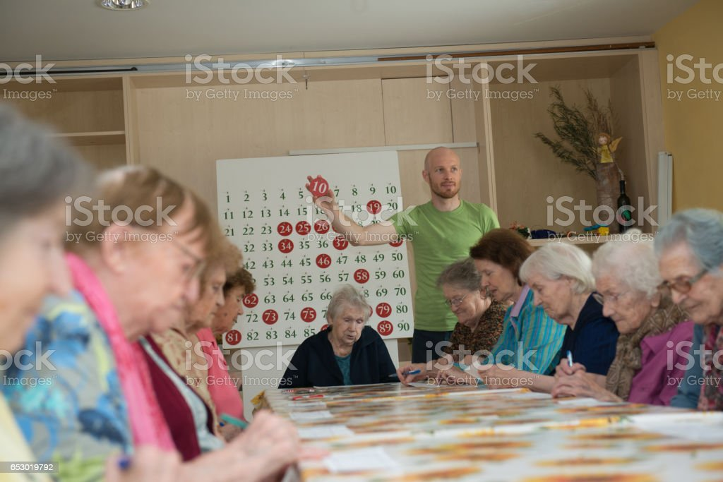 Seniors Playing Bingo At The Retirement Home stock photo