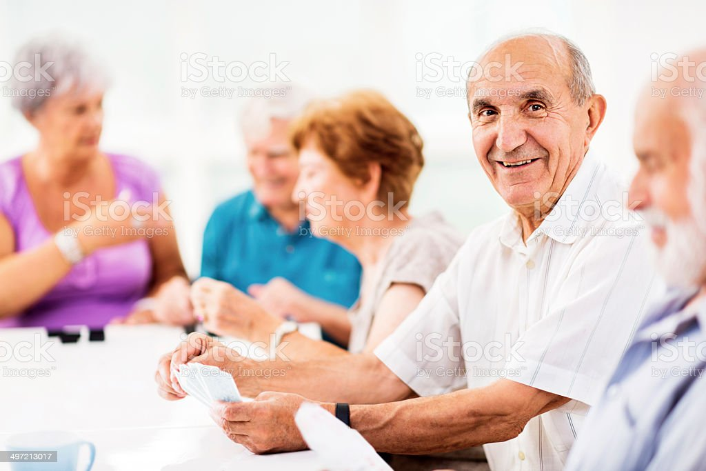 Seniors playing cards. stock photo