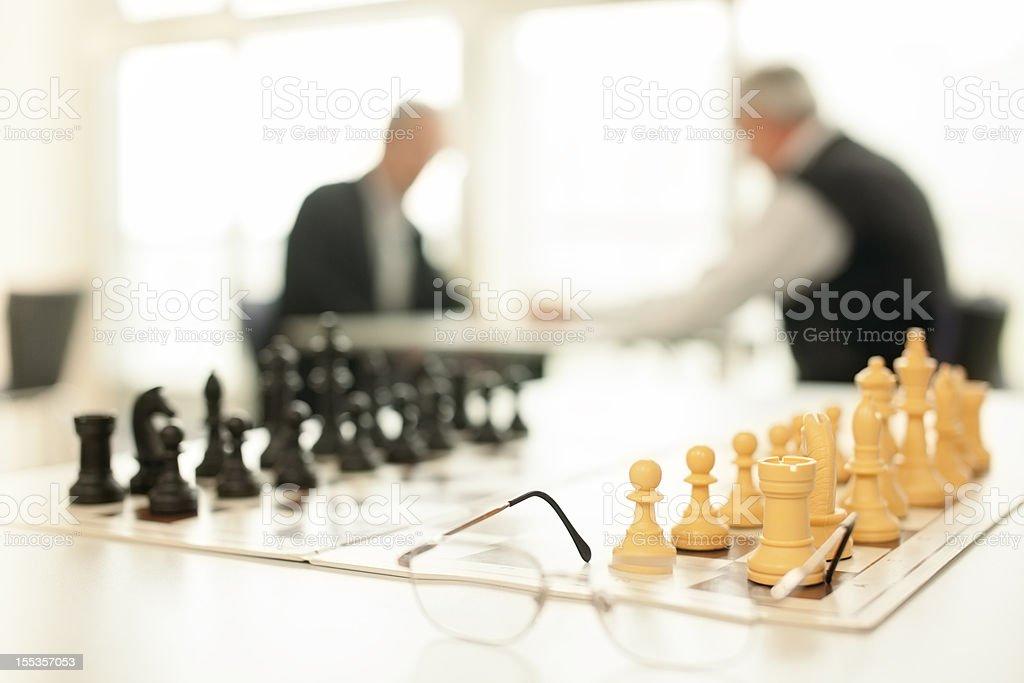 Seniors playing chess royalty-free stock photo