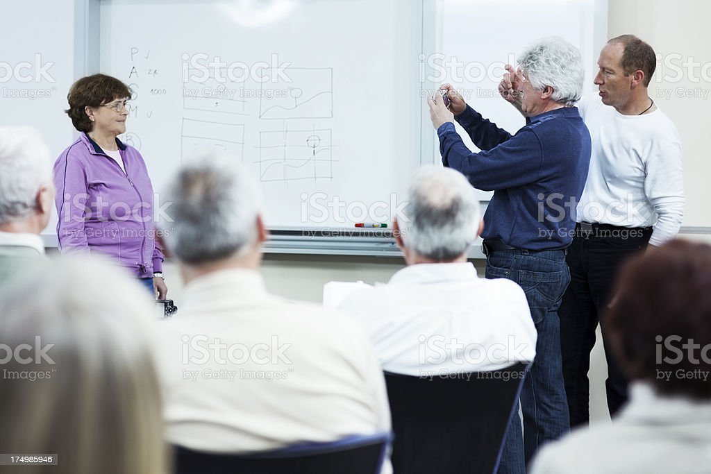Seniors Practicing Photographing royalty-free stock photo