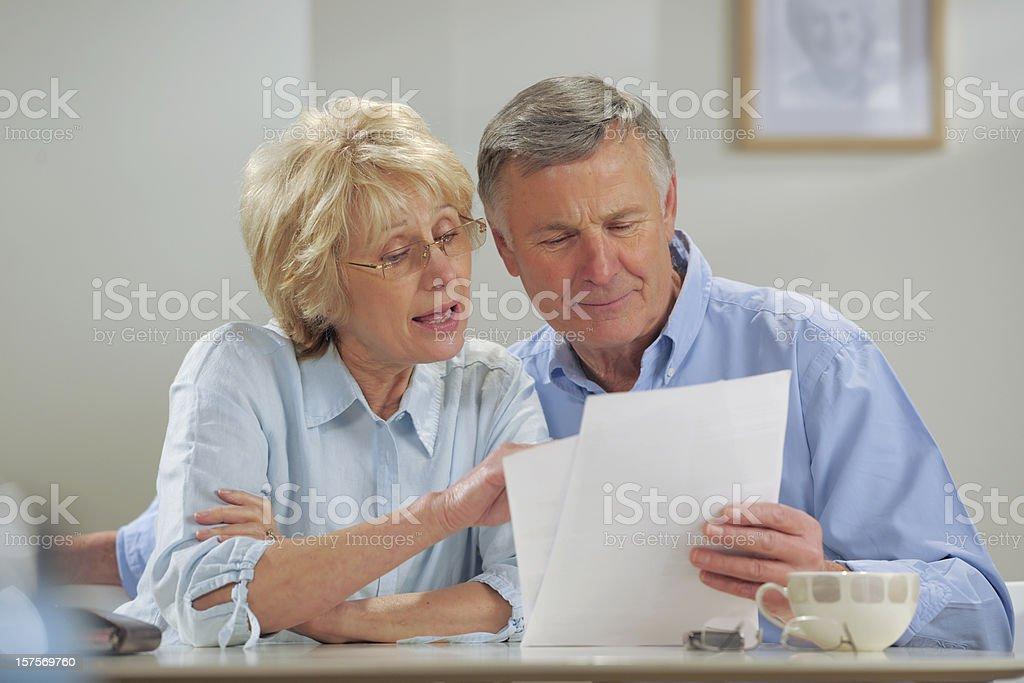 seniors reading paperwork royalty-free stock photo