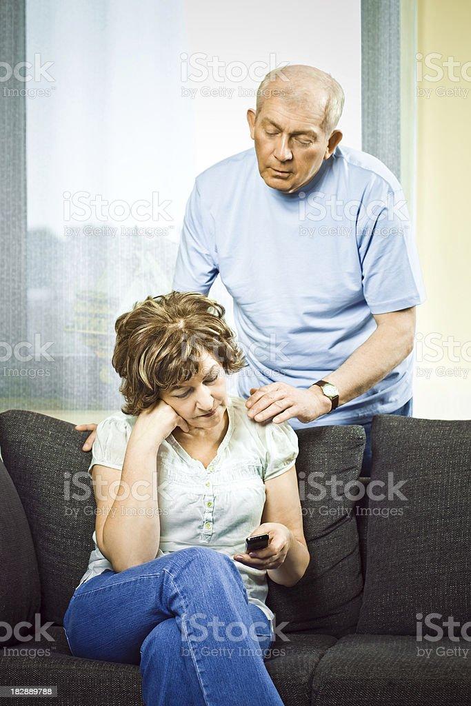 Seniors reciving bad news royalty-free stock photo