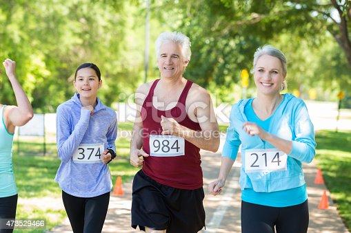 istock Seniors running marathon or 5k race in sunny park 473529466