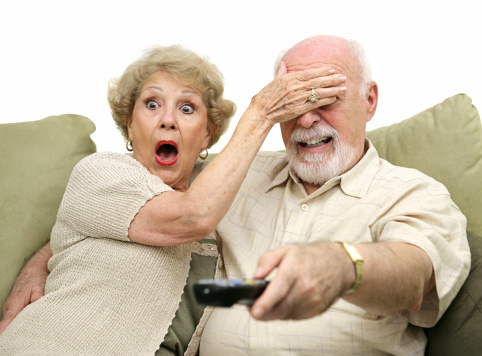 Seniors Shocked by TV stock photo. Image of protection