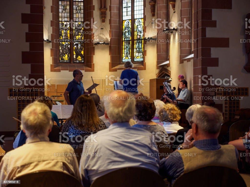 Seniors sing with church orchestra, Old St Nicholas Church, Frankfurt, Germany stock photo