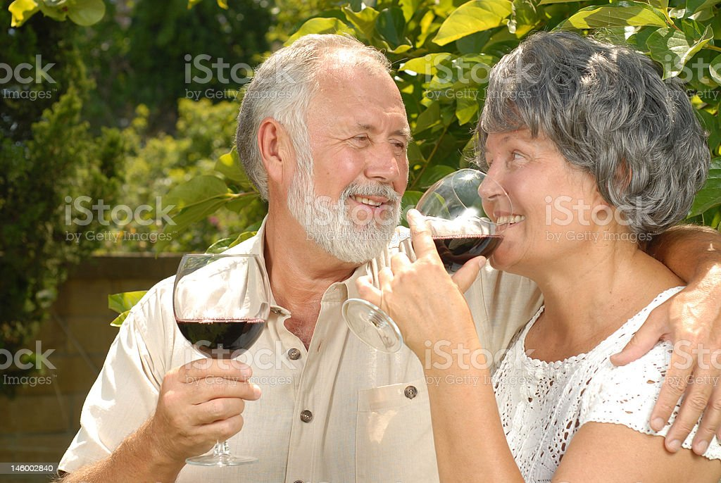 Seniors sipping wine royalty-free stock photo