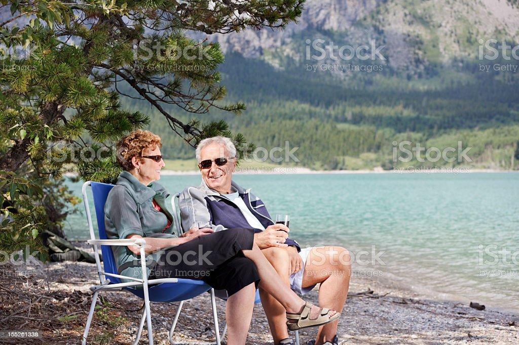 Seniors sit by the lake stock photo