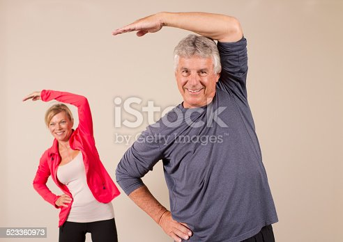 istock Seniors Stretching Left Man in Front 523360973