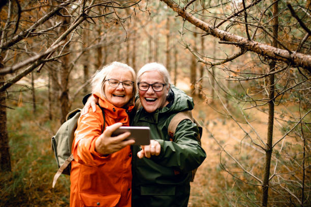 seniors taking a selfie - active lifestyle stock pictures, royalty-free photos & images