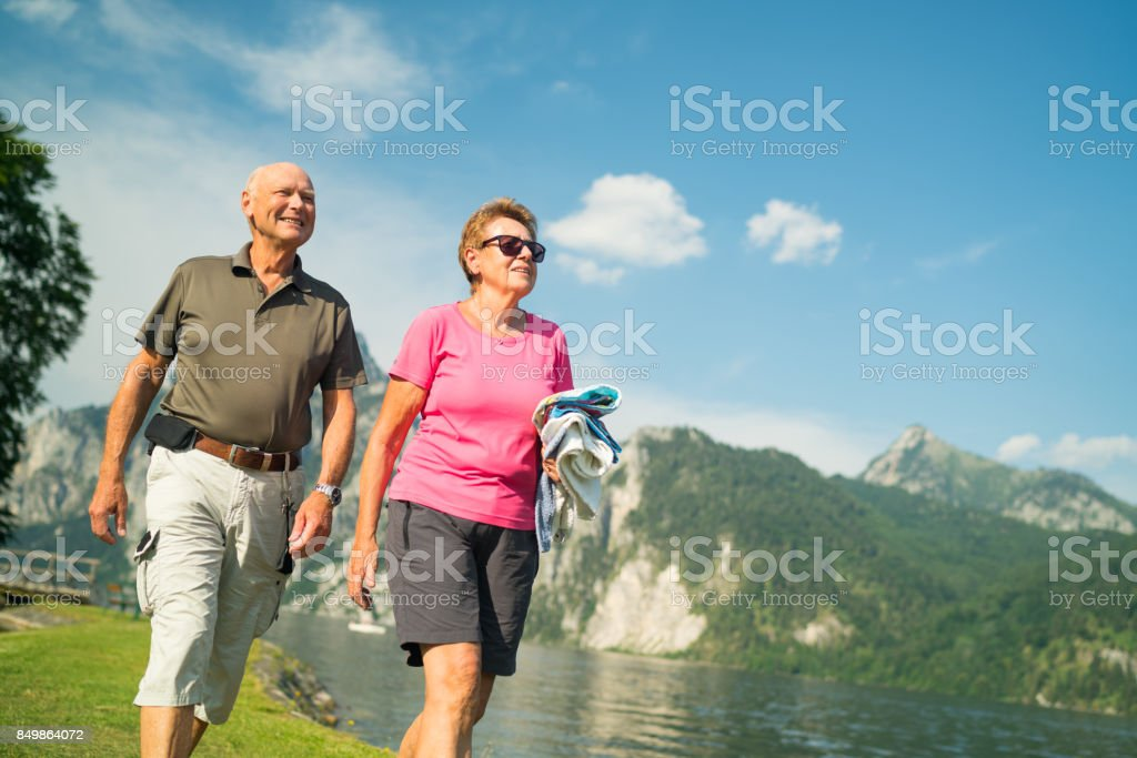 Seniors Taking on the World - couple summer vacation at austrian mountain lake stock photo