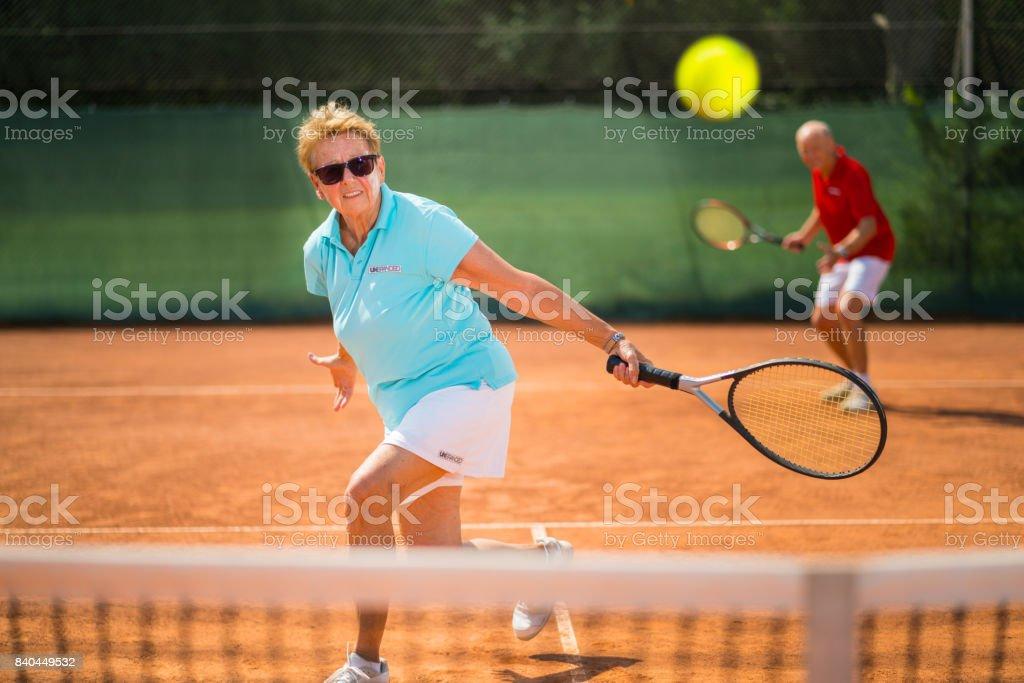 Seniors Taking on the World, real senior tennis players stock photo