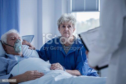 902077950istockphoto Seniors talking to doctor 932303002