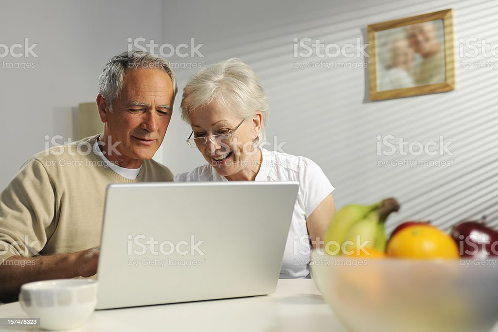 seniors using laptop royalty-free stock photo