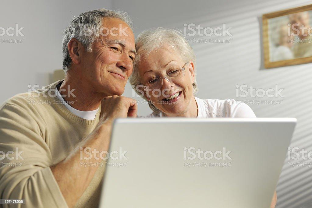 seniors using laptop royalty-free stock photo