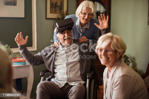 1053414472 istock photo Seniors using VR 1198940267