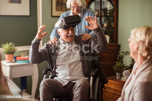 1053414472 istock photo Seniors using VR 1198940408