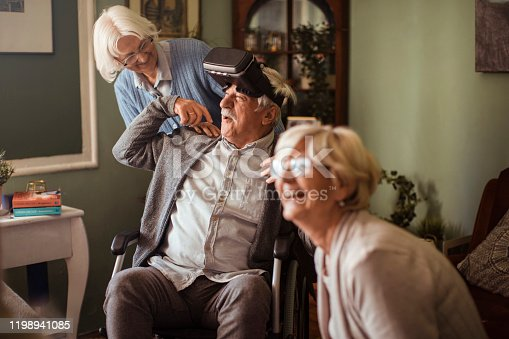 1053414472 istock photo Seniors using VR 1198941085